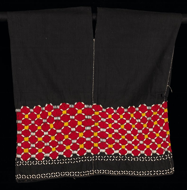 sleeveless; V-neck, front and back; wide band of red embroidered octagons, gold squares and white tubular seeds; two rows of seeds in X shapes below