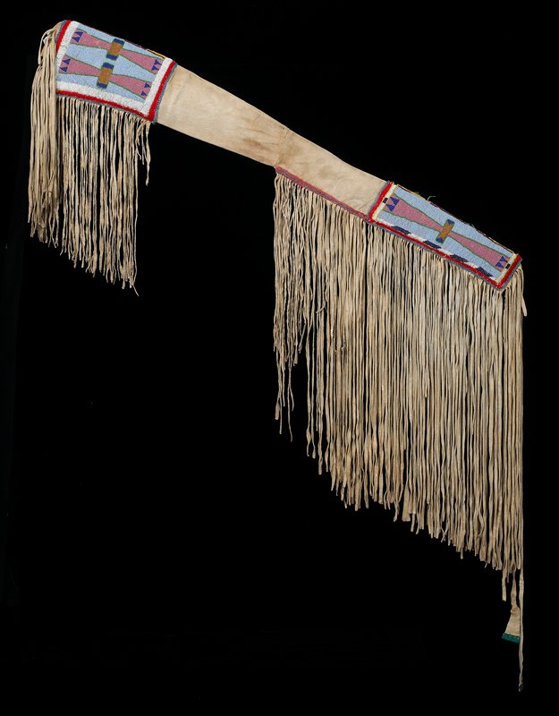 hide panel with beadwork at each end; wider end open; long fringe on each end and sides; geometric design beadwork with red felt and blue bead trim