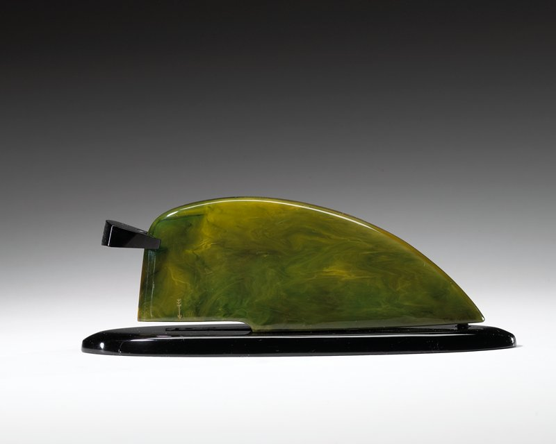 black ovoid base; green marbleized wedge shape on top; black stapler lever