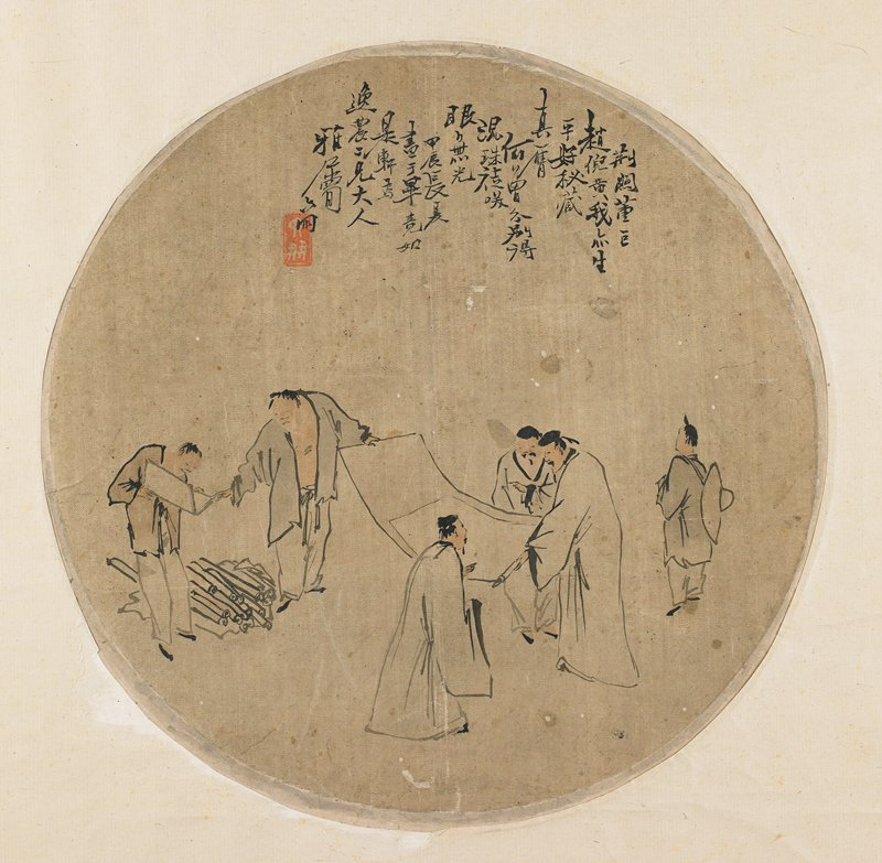 circular fan painting and frame, people looking at scrolls
