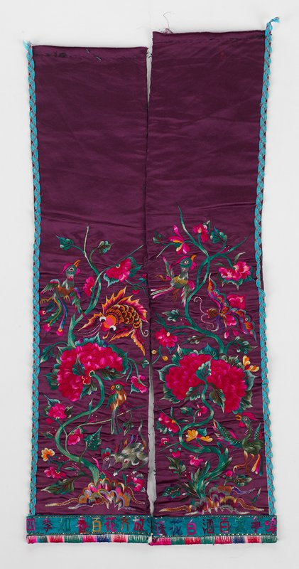 satin panels tacked just below center in purple; vibrant embroidery with birds, animals and flowers in multi-colors; embroidery in lower 2/3 of panels; scalloped narrow blue tape on outside edges; horizontal border of embroidered Chinese characters; paper lining with finished embroidery
