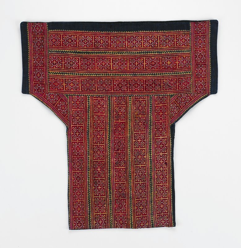 """black lining; coarse, applied dark blue linen bands (4"""") with embroidered cross stitch in geometric patterns; horizontal across top; vertical bands on lower section; red, yellow, white"""