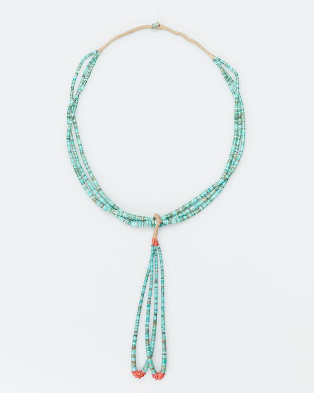 3 strands graduated turquoise beads with jacla attached; bound string and turquoise animal fetish at top