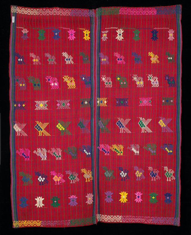 plaid; two panels joined with red stitches; four selvedges; red background with green, blue fine lines, vertical and horizontal; supplementary weft pattern with rows of birds and other zoomorphic figures in blue, yellow, green, pink, white, purple and pink; stylized floral motifs and geometric patterning at both borders