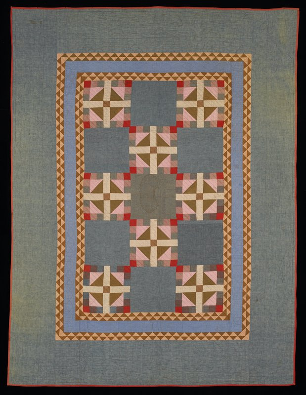 pieced design of squares, rectangles and diamonds, alternating with blue and grey blocks quilted with leaf designs; three inner borders of tan and brown triangles and blue fabric; blue denim border; brown backing