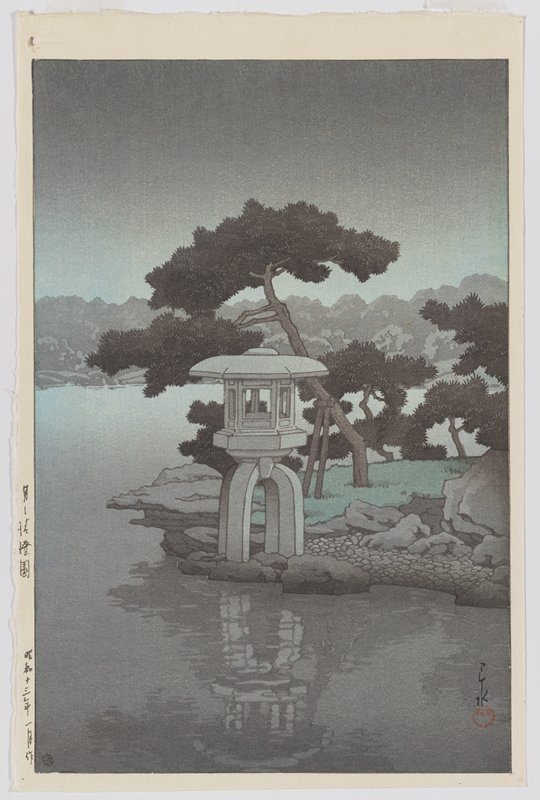 grey and green; nearly calm water in front of a small architectural shrine with trees behind; mountains on far shore