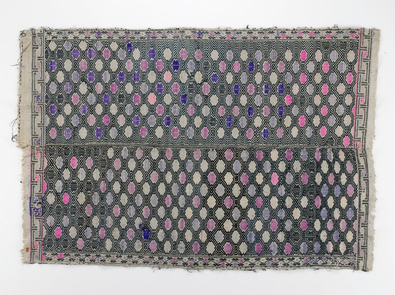 two joined panels embroidered overall in geometric shapes of pink, lavender, purple, black, rose, cream, pale green; bottom and top border in geometric design; side borders in floral design. Surface ornamentation