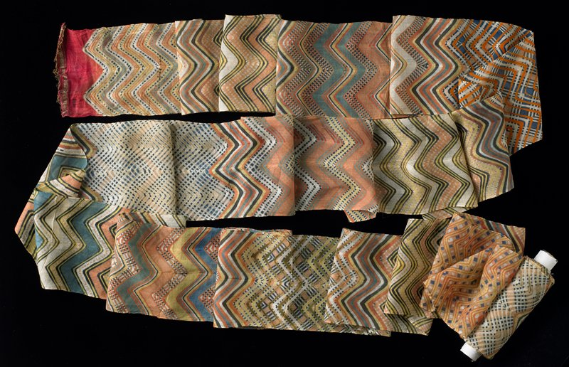 thin and delicate; orange, yellow, green, blue, black and white dyed zigzag patterns; red with gold threads at ends