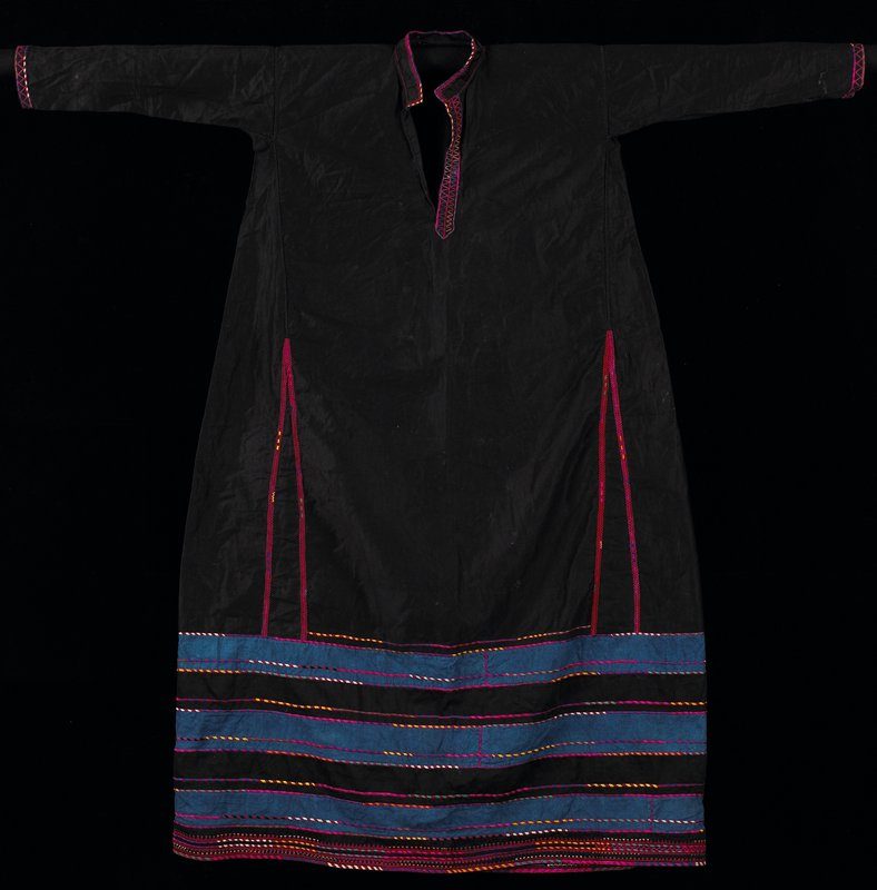 "pullover; slightly flared; black cotton sateen; three blue and two black horizontal bands accented by brightly colored embroidered 1/8"" bands forming bottom 14"" of garment; cuffs, neckline and four flared inserts accented by fuchsia embroidery"