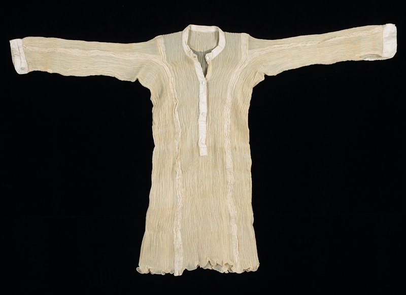 ecru crinkled silk with cotton cuffs, neck and front opening, with five mother-of-pearl buttons; sheer body, gauze-like, with vertical stripe from shoulder to bottom of plain weave silk; stripes on long sleeves; unusual sleeve construction; bottom edge tatted