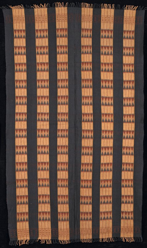 two panels sewn together; alternate stripes--blue and brown with patterning weft (blue, dark brown); fringes are twisted cords, knotted at ends