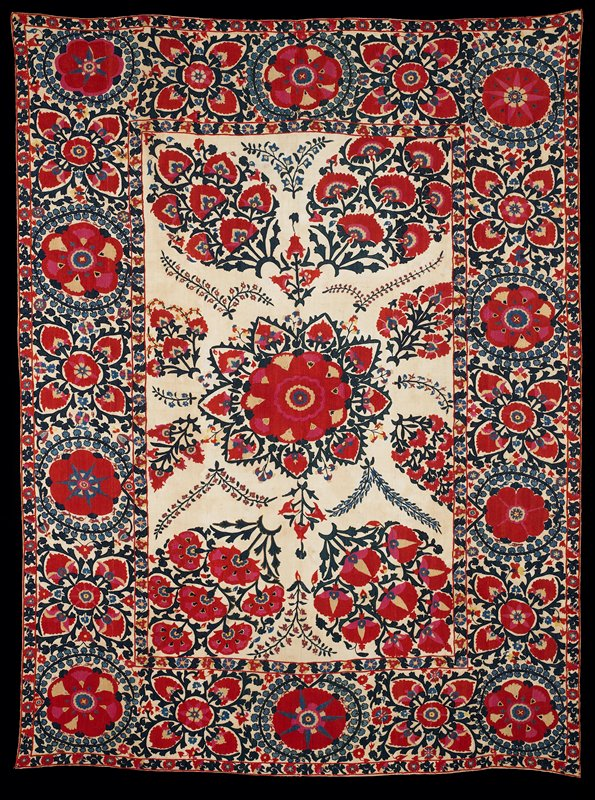 Newly lined.Red and dark blue silk on tan cotton ground. Large center motifs surrounded by wide embroidered border, the a narrow one. Six ground panels. Newer tan lining. Two adjacent velcro heading bands, lining attached all four sides