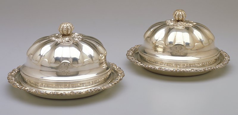 domed covers; repousse and applique leaf scroll borders; melon and leaf handle