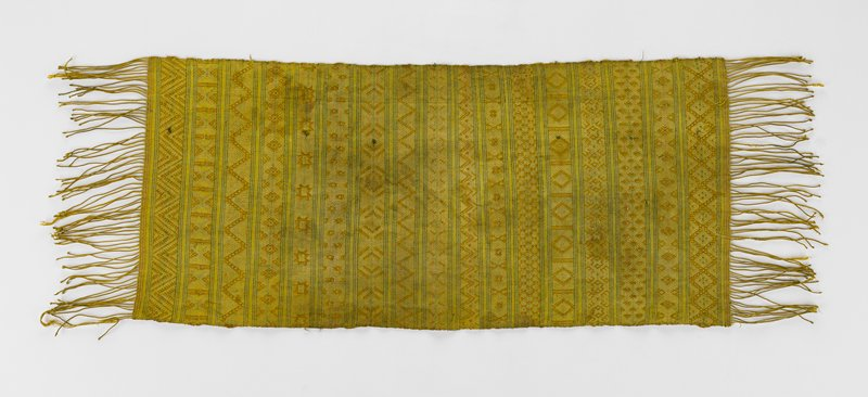 yellow/green reversible scarf with various geometric patterns woven in; ends fringed; metallic thread interwoven
