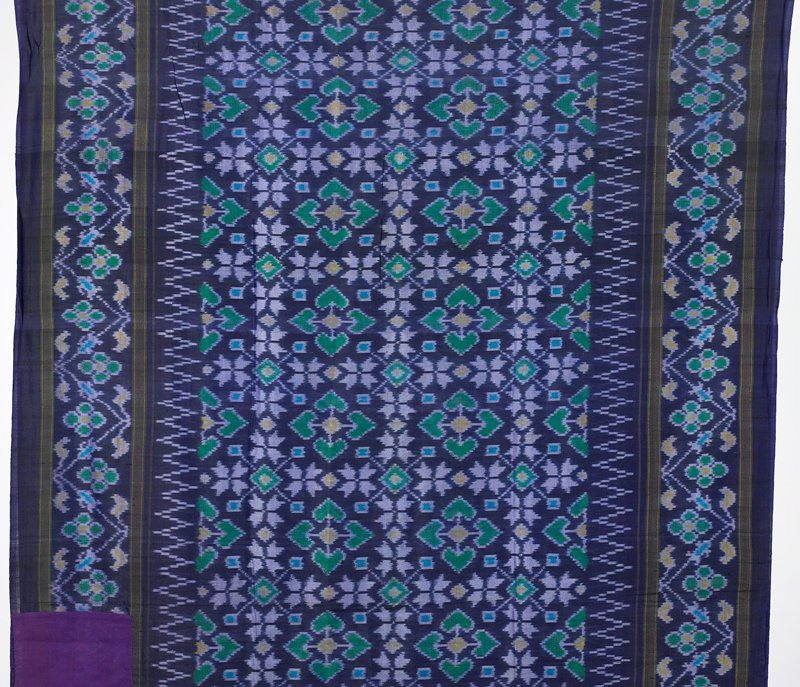 weft ikat; purple with green, yellow and blue geometric patterns