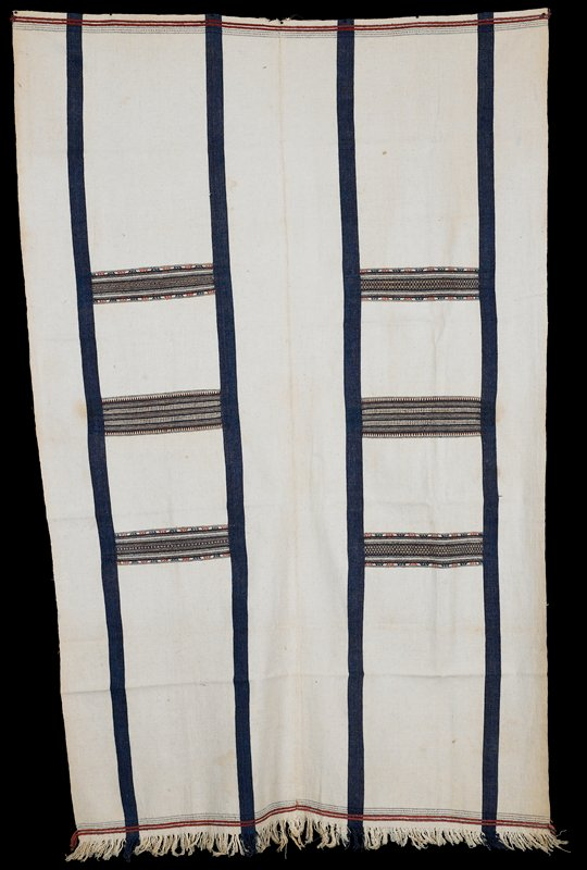 brocade; white with four blue stripes running through the length with six sections of brocade design, perpendicular to blue stripes; fringe on one end