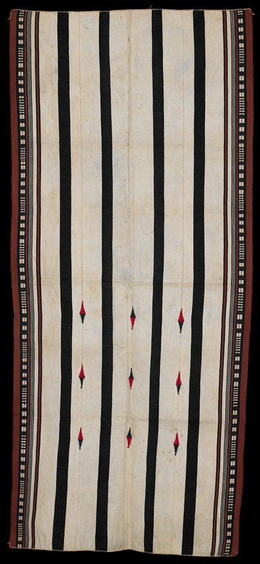 warp face, plain weave with some embroidery; four black stripes run the length on a beige ground; brown and black patterned edge; black/red diamonds in center