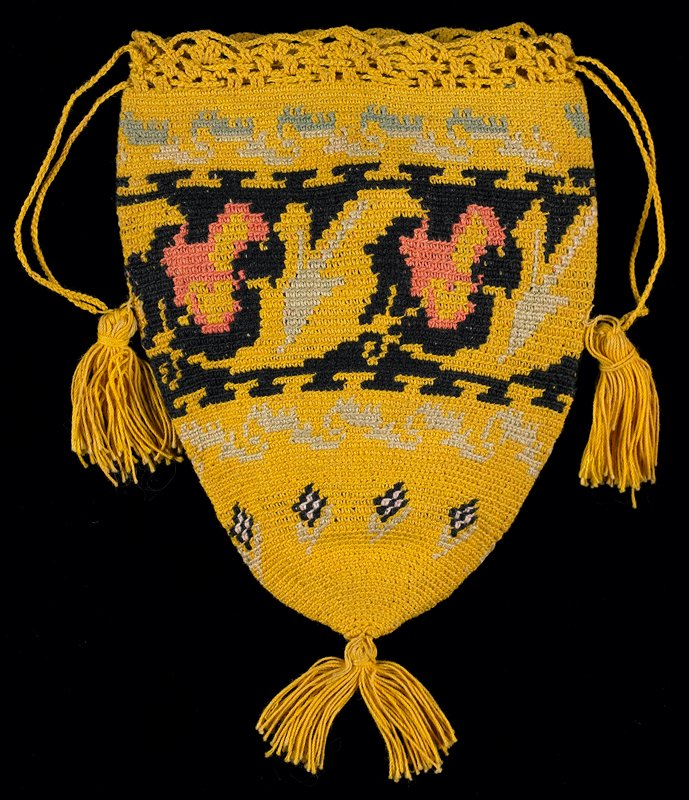 very tightly crocheted conical shape; open crocheted top edge with drawstring; yellow background with geometric patterns in black, greens, pinks; knotted tassels at bottom and sides