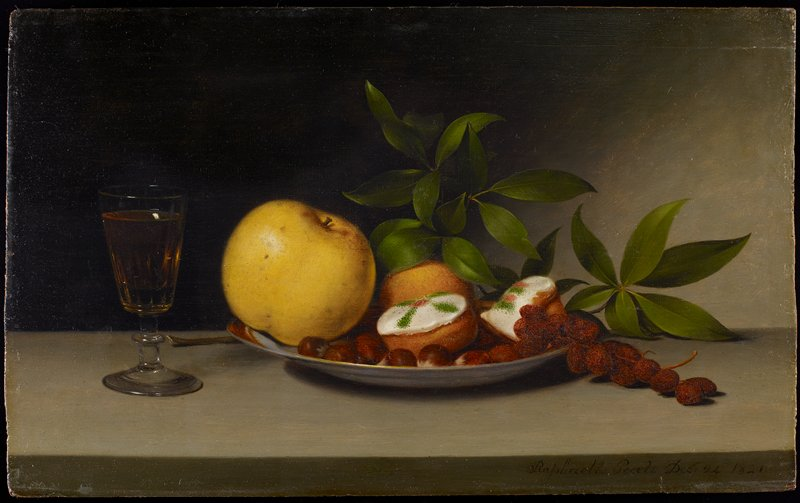 still life with plate with yellow apple, two frosted cakes, brown berries and an orange fruit, with leaves behind plate; small stemmed glass with pale yellow beverage at L