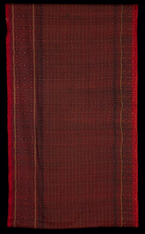 "silk woven in overall pattern of small diamonds bordered in large diamonds in red, gold and black; hand stitched seam in center of 37"" vertical stripe section; selvedge at top and bottom"
