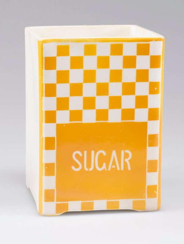 "open square container; porcelain with one side decorated with yellow-orange and white checkerboard and ""SUGAR"" in white"