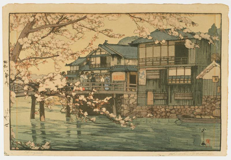 buildings by river with footbridge at L; figures on bridge; figure in boat at R; blooming cherry tree branches at L
