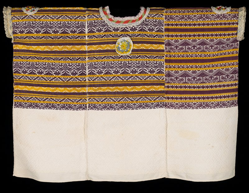 "large garment woven in three panels and stitched together; bottom 12"" off-white; top is maroon and gold woven horizontal geometric patterns; four medallions with lace edges forming a circle of multicolor polyester ribbon flowers; neck and sleeves piped in lace"