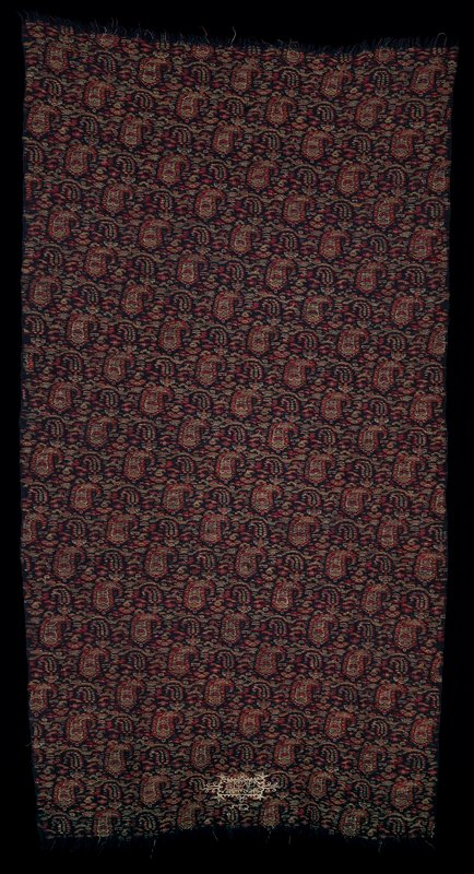 dark blue background with supplemental weft in paisley pattern in dark red, pink, off-white and apricot; embroidered inscription of maker at top with Islamic date of 1350 i.e. 1925; used as band to wrap around waist