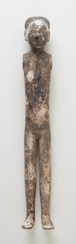 standing nude female; thin with very long legs; flat feet; arms lost; hair in low ponytail; white, grey, and black mottled patina