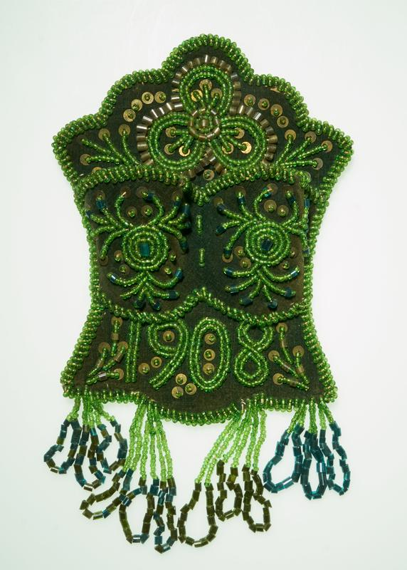 "green velvet with green, clear and blue beads and gold sequins; yellow backing; black velvet hanging cord; two pouches; swirling designs; ""1908"" on bottom below pouches"