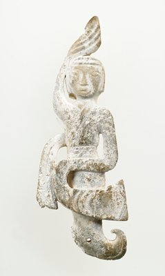 calcified ivory jade; dancer's legs terminate in a fish tail through which a pendant hole is drilled
